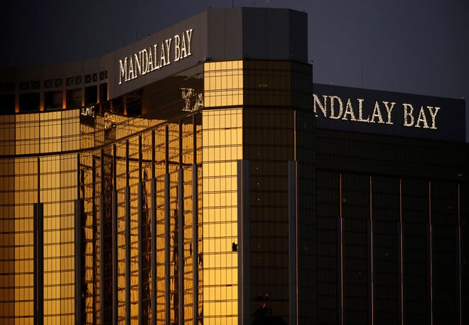 This photo, taken two days after the Oct. 1, 2017, mass shooting in Las Vegas, shows broken windows where a gunman perched to fire upon nearly 20,000 revelers who had gathered at an outdoor country music concert across the street from the Mandalay Bay hotel; 58 were killed and more than 800 were wounded.