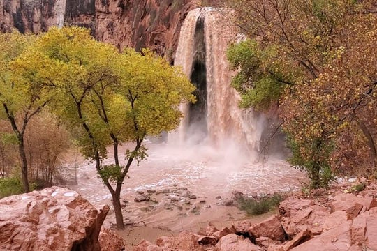 This Nov. 29, 2019, photo, shows a normally blue-green waterfall in Supai, Arizona, that turned chocolate brown after flooding. Havasupai falls, a popular tourist spot deep in a gorge off the Grand Canyon was flooded over the holiday, sending tourists scrambling to higher ground.