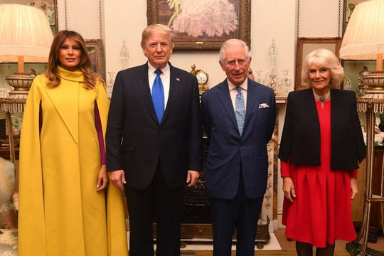 Britain's Prince Charles and the Duchess of Cornwall, right, pose for a photo with US President Donald Trump and wife Melania, at Clarence House as NATO leaders gather in London.