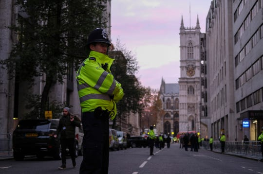 A London policeman stands guard outside Central Hall Westminster, in London, on  Dec. 3, 2019. The venue is hosting several NATO leaders and senior diplomats Tuesday for a conference on the military alliance.