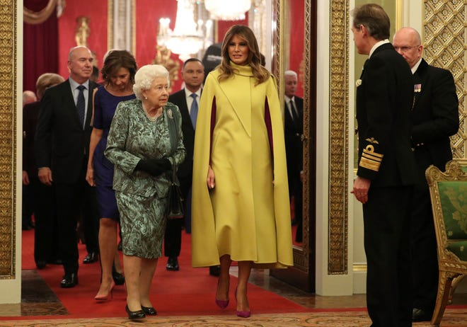 Queen Elizabeth II, with first lady Melania Trump during a reception the monarch hosted for NATO leaders at Buckingham Palace, on Dec. 3, 2019. President Donald Trump also attended the reception.