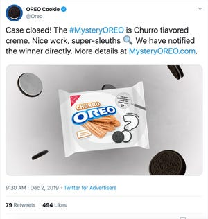 A screenshot of a tweet from Oreo confirming their new mystery flavor: churro