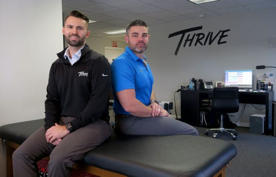 Thrive Spine & Sports Rehab co-founders AJ Adamczyk (left) and Dr. Joseph Marchitelli are shown together in their Spring Lake office Tuesday, November 26, 2019.
