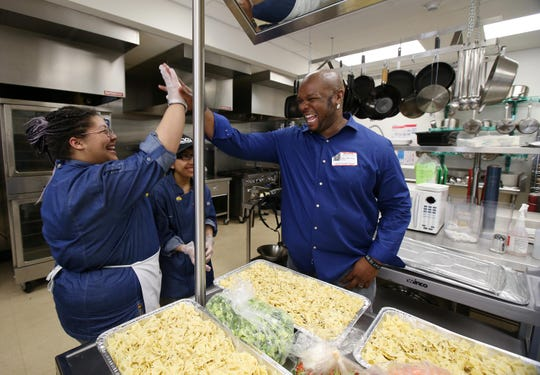 Aaron McCargo Jr. is a Camden native who won season 4 of 'Food Network Star' in 2008 and had his own cooking show 'Big Daddy's House.' Here, McCargo high-fives Lakewood High School culinary students during a food competition in 2019.