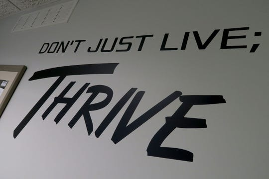 Logo on the wall at Thrive Spine & Sports Rehab in their Spring Lake office Tuesday, November 26, 2019.