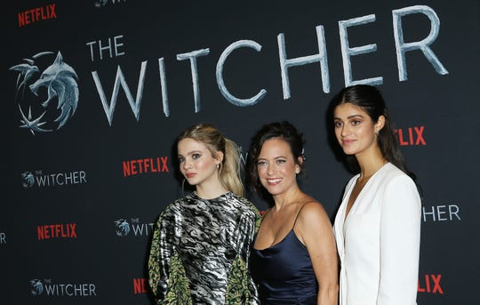 """Actress Freya Allan, from left, executive producer Lauren Schmidt Hissrich  and actress Anya Chalotra  attend Netflix's """"The Witcher"""" Season 1 photo call held at The Egyptian Theatre in Hollywood, California on Dec. 3, 2019."""