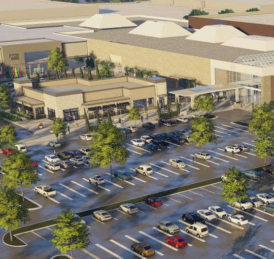 A rendering of the proposed new revisions to Monmouth Mall show a proposed restaurant and glass covered entrance way.