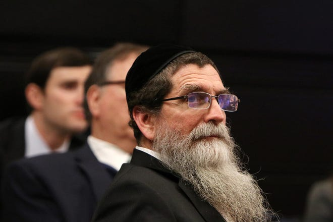 Rabbi Osher Eisemann, the founder of Lakewood's School for Children with Hidden Intelligence who is accused of diverting nearly $1 million meant to educate special needs students to his own interests, listens to closing statements during trial before Superior Court Judge Benjamin Bucca Jr. at the Middlesex County Courthouse in New Brunswick, NJ.