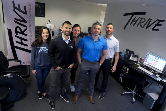 The staff at Thrive Spine & Sports Rehab are shown together in their Spring Lake office Tuesday, November 26, 2019.  They are (l-r):  office manager Kaitlyn French, co-founder AJ Adamczyk, secretary Melissa LaTorre, co-founder Dr. Joseph Marchitelli, and physical therapist Ed Kinsella.