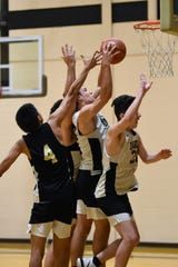 Abilene High's Dylan Wright (10) grabs a contested rebound during the team's practice.