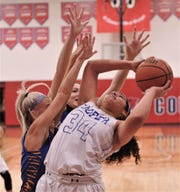 Cooper's Kaleigha Kemp (34) tries to shoot while being pressured by two Wolfforth Frenship defenders.