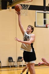 Abilene High's Nathan Watts (32) lays the ball in during the team's practice Tuesday.