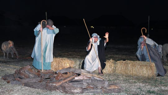 From left, Jon McAden, Kyle Coker and J.D. Shaeffer are shepherds in the West Texas field in Zion Lutheran Church's Journey to Bethlehem.