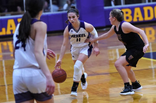Merkel's Kaydi Pursley (11) brings the ball down the court guarded by Wylie's Makinlee Bacon (25) on Tuesday. Prusley scored a game-high 10 points as the Lady Badgers won 31-18.