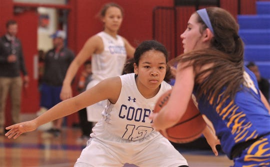 Cooper's Kayla Speights (13) defends against a Wolfforth Frenship player.