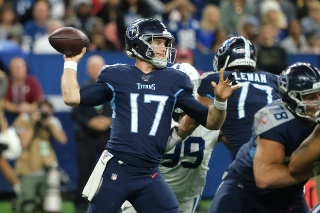 Tennessee Titans quarterback Ryan Tannehill (17) throws against the Indianapolis Colts during the first half in Indianapolis, Sunday, Dec. 1, 2019.