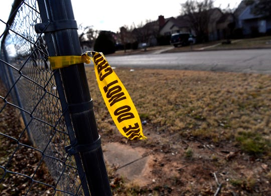 A scrap of police tape flutters in the breeze in the 1000 block of Cedar Street on Wednesday afternoon. A man was fatally shot Tuesday evening, and Abilene police are searching for a suspect or suspects. They believe the victim was targeted.