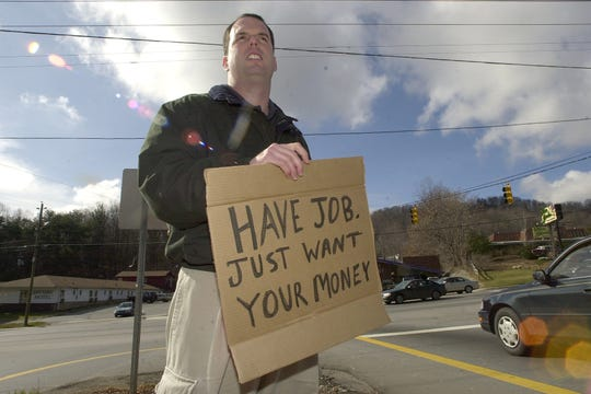 Back in 2001, columnist John Boyle tried his hand at panhandling, making less than $2 in a few hours.