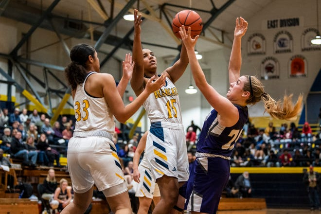 Battle Creek Central junior Arieonna Ware (15) and sophomore Shayla Ardis (33) battle for the rebound from Lakeview senior Annalisse Palma (20)  on Tuesday, Dec. 3, 2019 at the Battle Creek Central Fieldhouse in Battle Creek, Mich. Battle Creek Central defeated Lakeview 43-38.