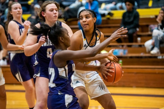 Battle Creek Central junior Arieonna Ware (15) passes the ball as Lakeview senior Jayla Carpenter (22) covers her on Tuesday, Dec. 3, 2019 at the Battle Creek Central Fieldhouse in Battle Creek, Mich. Battle Creek Central defeated Lakeview 43-38.
