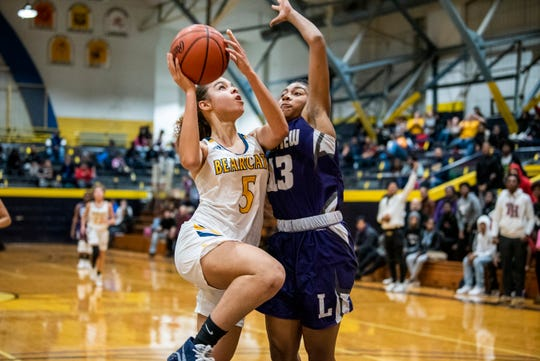 Battle Creek Central senior Kandis Orns (5) attempts a basket as Lakeview junior Brazyll Watkins (13) covers her on Tuesday, Dec. 3, 2019 at the Battle Creek Central Fieldhouse in Battle Creek, Mich. Battle Creek Central defeated Lakeview 43-38.