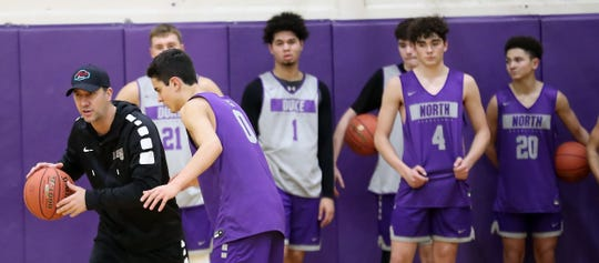 North Kitsap head coach Scott Orness gives instructions as the team runs through drills during practice on Tuesday, December 3, 2019.