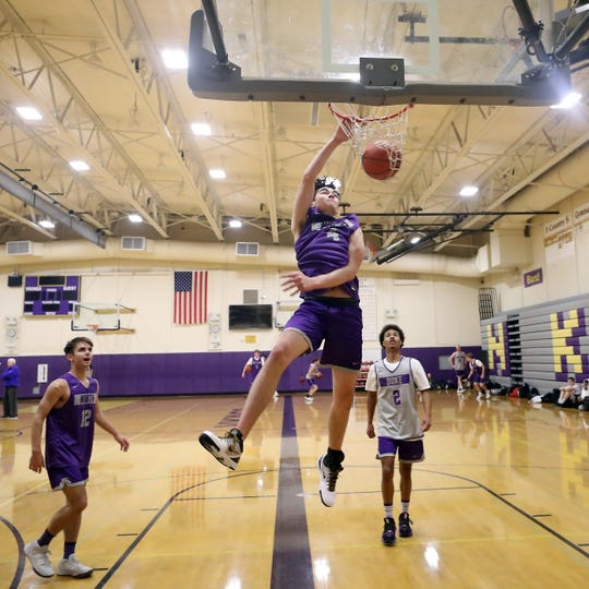 North Kitsap's Jonas La Tour dunks the ball during basketball practice on Tuesday, December 3, 2019.