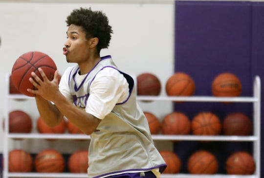 North Kitsap's Kobe McMillian and the Vikings have won three West Central District boys basketball titles in the past four years.