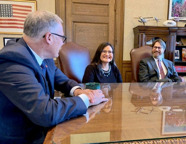 Gov. Jay Inslee meets with Judge Raquel Montoya-Lewis moments before he officially announces her appointment to the Washington State Supreme Court.