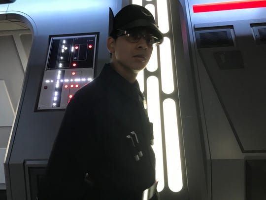 A First Order guard gives commands to Resistance prisoners before they are taken to a holding cell inside a Star Destroyers as part of the Rise of the Resistance ride at Disney's Hollywood Studios.