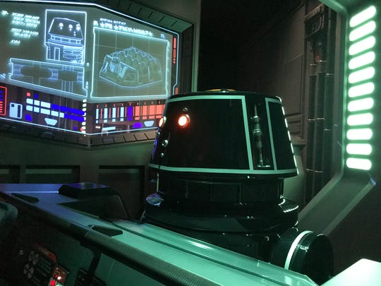 A droid pilots Resistance fighters as they escape from a holding cell inside the Rise of the Resistance ride at Disney's Hollywood Studios.