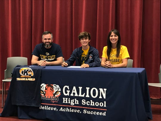 Galion's Braxton Tate signs his letter of intent to run at Kent State University in the fall.