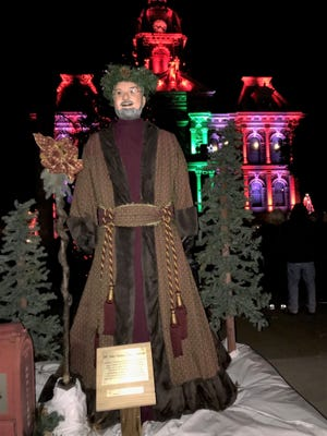 A mannequin depicting Father Christmas stands before the Guernsey County Courthouse as the music and light show is shared during the Dickens' Victorian event. The show continues nightly through Dec. 31.