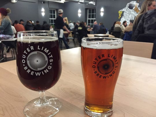 A dark mild beer and an American pale ale at Outer Limits Brewing in Proctorsville.