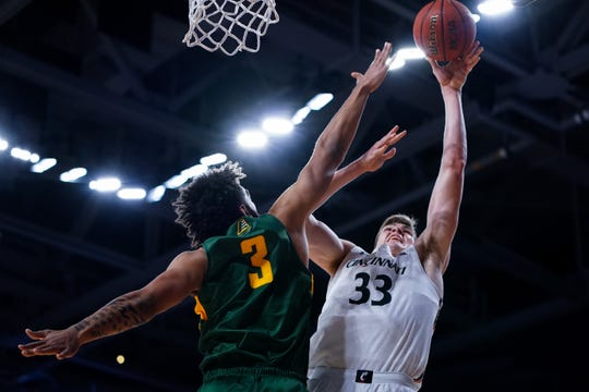 Dec 3, 2019; Cincinnati, OH, USA; Vermont Catamounts forward Anthony Lamb (3) defends as Cincinnati Bearcats center Chris Vogt (33) in the first half at Fifth Third Arena. Mandatory Credit: Aaron Doster-USA TODAY Sports