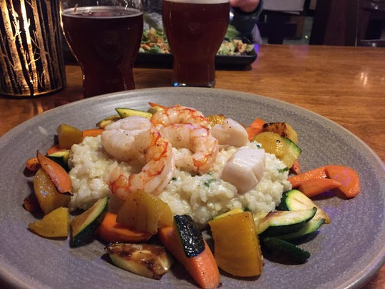 Seafood risotto in coconut milk with an Irish red ale and amber ale at the Hotel Roquemont resto-pup-microbrewery in St. Raymond, Quebec.
