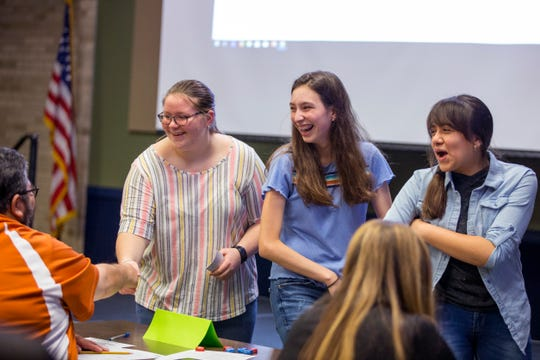 Collegiate High School students Hailey Hernandez, from left, Morgan Tullos, and Maria Diaz thank judges after presenting their project on teen period poverty at Del Mar College on Wednesday, December 4, 2019. The school participates in the Speak Up! Speak Out! civic education program sponsored by the University of Texas at Austin.