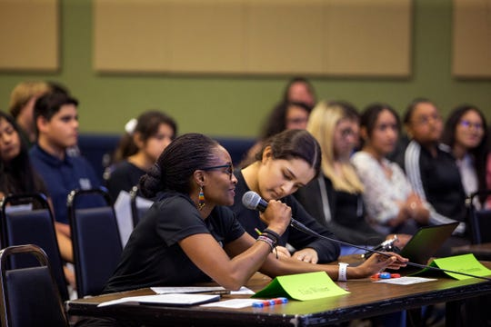 Liza Wizen, left, with the City of Corpus Christi, and Ariela Florentino, student judge from Collegiate High School, ask questions of collegiate students presenting projects on local issues at Del Mar College on Wednesday, December 4, 2019. The school participates in the Speak Up! Speak Out! civic education program sponsored by the University of Texas at Austin.