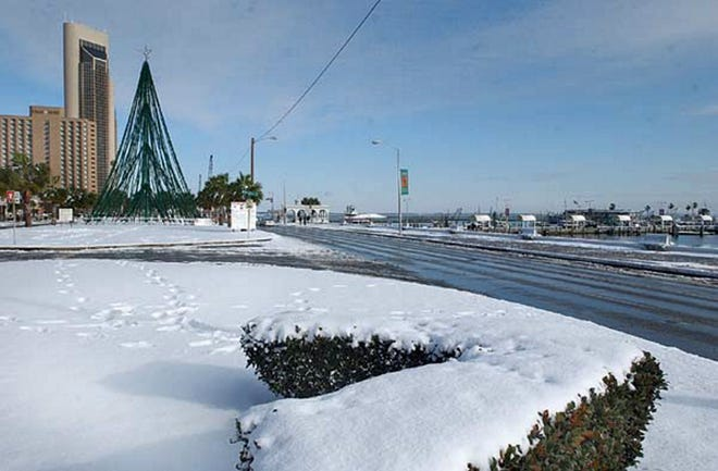 Shoreline Boulevard with the Harbor Lights Christmas tree in the background look festive under a blanket of snow on Dec. 25, 2004.