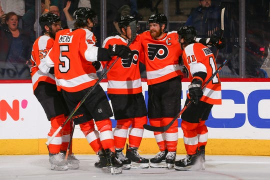 Five goals in less than 10 minutes put a stamp on the Flyers' five-game winning streak.