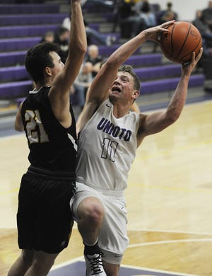 Unioto guard Isaac Little puts a shot up at the rim in a 70-39 win over Miami Trace on Tuesday Dec. 3, 2019 at Unioto High School in Chillicothe, Ohio.