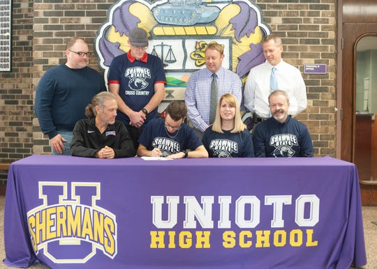 Unioto senior Eric Hacker officially signed with Shawnee State University to run cross country and track collegiately after high school.