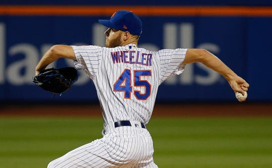 Sep 26, 2019; New York City, NY, USA; New York Mets starting pitcher Zack Wheeler (45) pitches against the Miami Marlins at Citi Field. Mandatory Credit: Andy Marlin-USA TODAY Sports