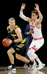 Northern Kentucky Norse guard Tyler Sharpe (15) looks for a pass under pressure from Miami (Oh) Redhawks guard Milos Jovic (15) in the first half of the NCAA basketball game between the Miami (Oh) Redhawks and the Northern Kentucky Norse at Millet Hall in Oxford, Ohio, on Tuesday, Dec. 3, 2019. The Norse led 29-22 at halftime.