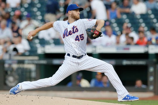 Jul 2, 2019; New York City, NY, USA; New York Mets starting pitcher Zack Wheeler (45) pitches against the New York Yankees during the first inning at Citi Field. Mandatory Credit: Brad Penner-USA TODAY Sports