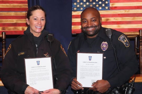 Colerain Police Officer Chris Thomas and Hamilton County Sheriff's Deputy Joann Bradley were honored by the Colerain Police Department Tuesday.