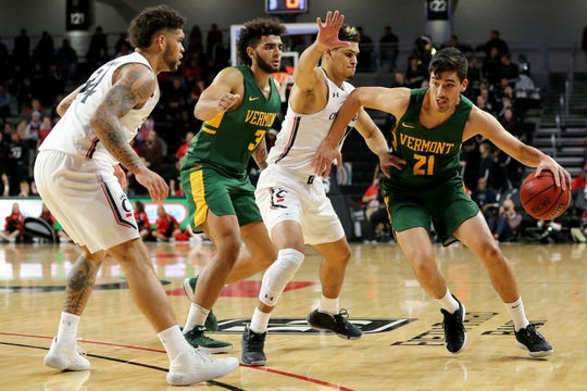 Vermont Catamounts guard Everett Duncan (21) drives to the basket as Cincinnati Bearcats guard Jaevin Cumberland (21) defends during the first half of a NCAA college basketball game, Tuesday, Dec. 3, 2019, at Fifth Third Arena in Cincinnati.