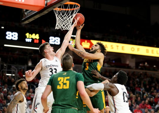 Cincinnati Bearcats center Chris Vogt (33) blocks a shot by Vermont Catamounts forward Anthony Lamb (3) during the first half of a NCAA college basketball game, Tuesday, Dec. 3, 2019, at Fifth Third Arena in Cincinnati.