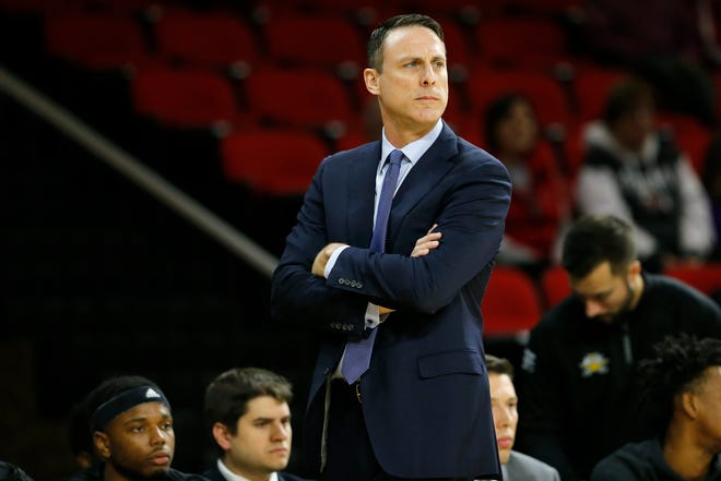Northern Kentucky Norse head coach Darrin Horn paces the sideline in the first half of the NCAA basketball game between the Miami University RedHawks and the Northern Kentucky Norse at Millet Hall in Oxford, Ohio, on Tuesday, Dec. 3, 2019. The Norse led 29-22 at halftime.