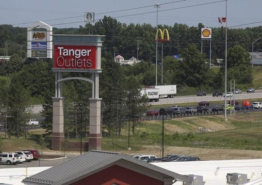 A lawsuit accuses Tanger Outlets and its tenants of applying a hidden charge to customers.